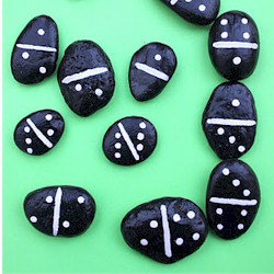 dominos made from painted rocks