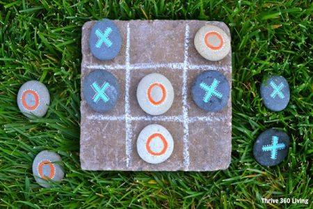tic tac toe game made with painted rocks