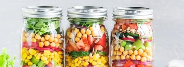 mason jars full of layered vegetables