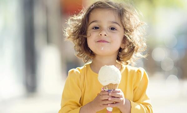 little girl eating an ice cream cone