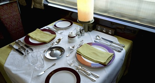 Table set with china in a train dining car