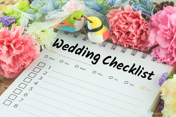wedding checklist with flowers and bird decorations