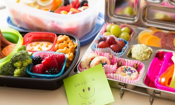 """bento lunch boxes filled with food and a note that says """"Have a good day"""""""