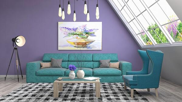 Living space with purple wall and turquoise sofa.