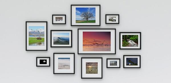 Wall of framed photographs.