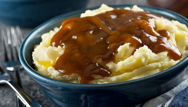beef gravy on bowl of mashed potatoes