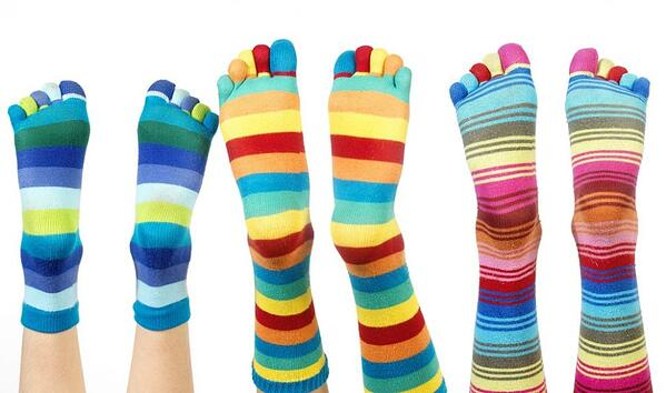 feet wearing striped toe socks