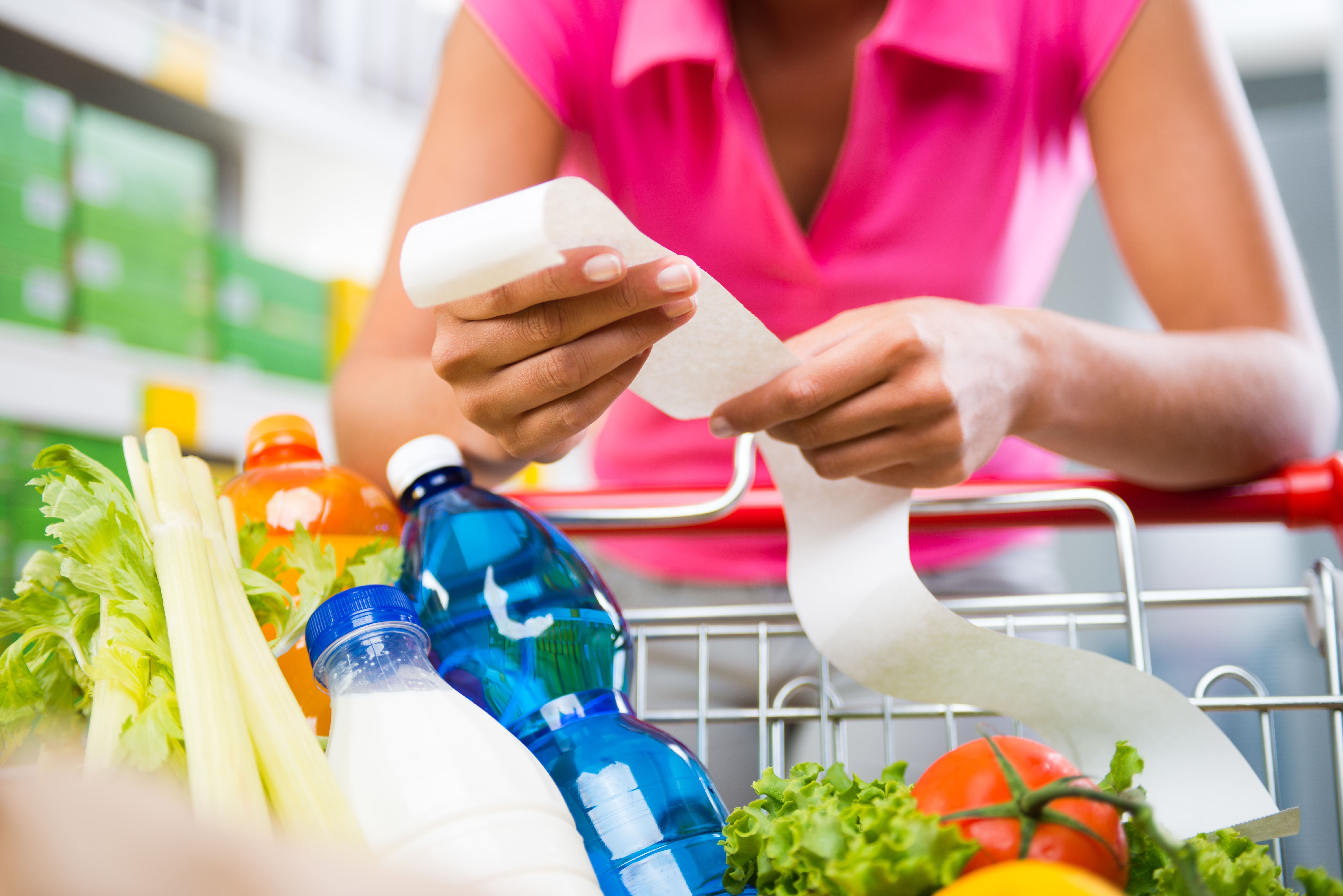 woman looking at a grocery receipt